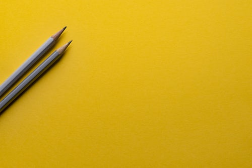 pencils on yellow background