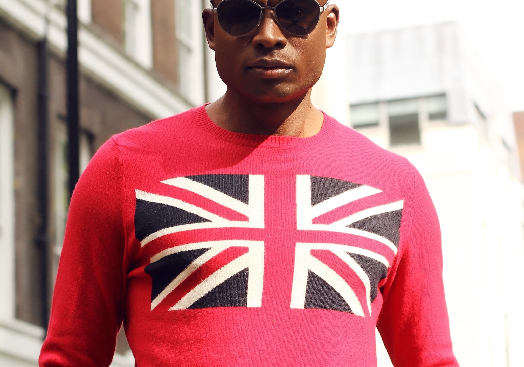 man wearing red top with union jack